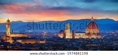 Florence, Tuscany, Italy. Panorama Sunset view at Duomo Santa Maria del Fiore cathedral and Palazzo Vecchio Tower. Panoramic View of Firenze during sunset. Scenic landscape mountains evening sky. Stock photo ©