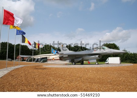 FLORENNES, BELGIUM - JULY 6: Belgian Air Force Lockheed F-16 on display at the entrance of the airbase. Belgian Defence Days. July 6, 2008 in Florennes, Belgium