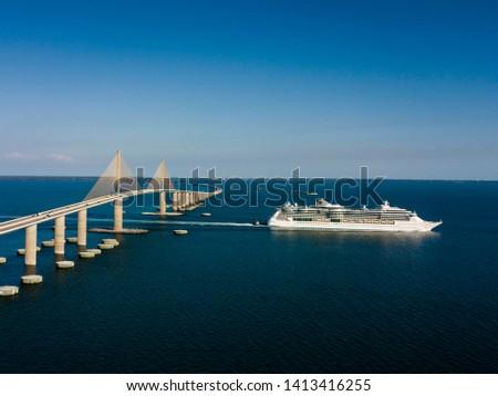 Florida cruise ship passes below the beautiful Sunshine Skyway bridge near St Petersburg Florida  #1413416255