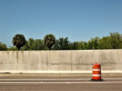 Florida highway with orange and white traffic barrel