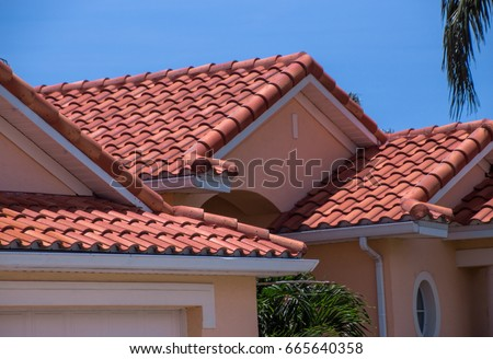 Florida home with spanish tiled roof #665640358
