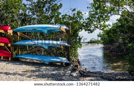 Florida Keys Canoe Launch:  Rental canoes and kayaks wait beside a launch area in Long Key State Park.