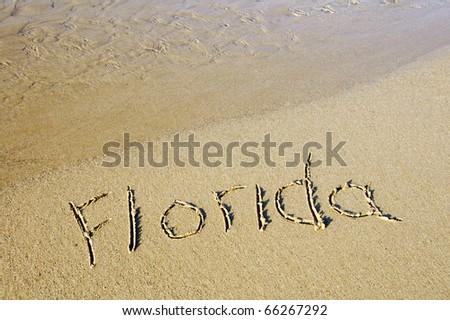 Florida written on the sand of a beach