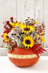 Florist at work: How to make a Thanksgiving centerpiece with big pumpkin and bouquet of flowers. Step by step, tutorial.