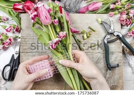 Florist at work Woman making spring floral decorations
