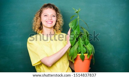 Florist concept. Botany and biology lesson. Botanical expert. Botany education. Botany is about plants flowers and herbs. Woman chalkboard background carry plant in pot. Take good care plants. #1514837837