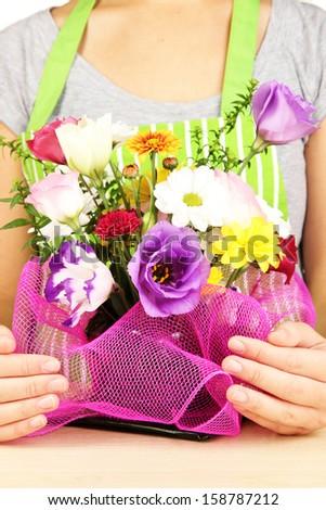 Florist makes flowers bouquet