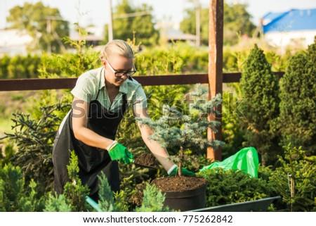 Florist-woman working with seedlings #775262842