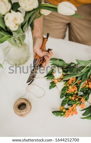 florist working with pruning shears orange flowers Сток-фото ©
