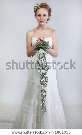 Floristry - lovely bride blond with bouquet of fresh tender flowers - series of photos
