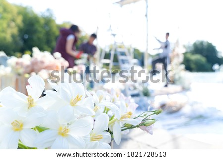 Florists mount, decorate with flowers arch for wedding ceremony for bride, groom. Making floral compositions from roses, tulips, peonies,orchids.Decorators working at event:birthday,anniversary,party. Stok fotoğraf ©