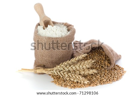 Flour and wheat grain in small canvas sacks