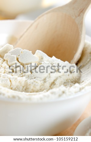 Flour and wooden spoon closeup
