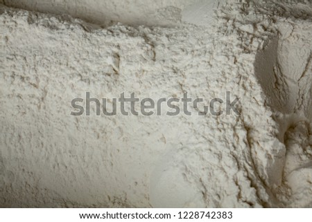 flour background. White flour texture ready for cooking. A pile of flour on a white background. bakery. Surface covered with the wheat flour as a background