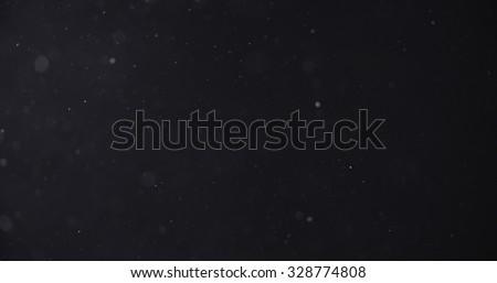 flour dust particles on black background, motion blur
