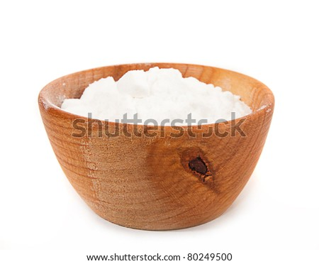 flour in a wooden platter isolated on a white background