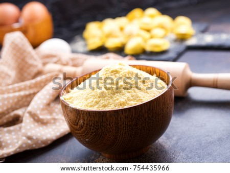 flour  in bowl and on a table #754435966
