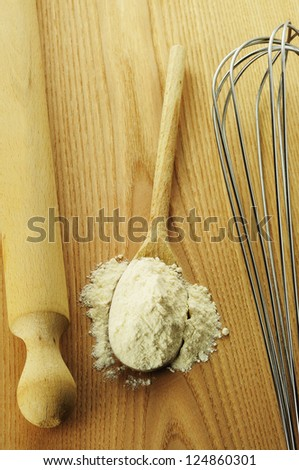 Flour on a wooden chopping board