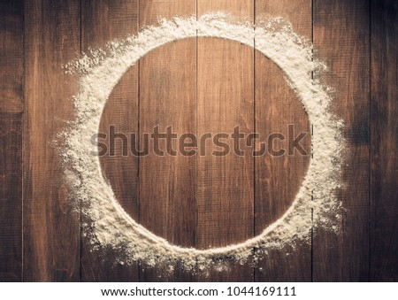 flour powder on wooden background
