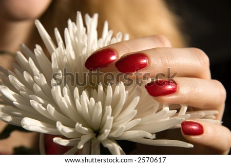 Flower and fingers.