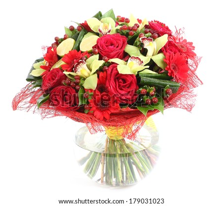 Flower arrangement in glass, transparent vase: red roses, orchids, red gerbera daisies. Isolated on white background. Floristic composition, design a bouquet, floral arrangement.