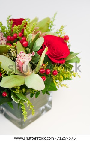 Flower arrangement in holiday colors.