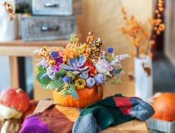 flower arrangement in pumpkin