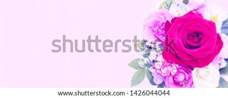 Flower arrangement on a pink background. Roses of different colors-red, white and pink. Pastel soft tones. Background for greetings, invitations, cards for wedding day or women's day.