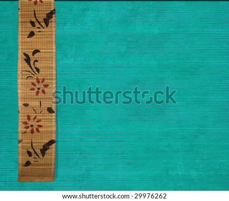 flower bamboo banner on aquamarine ribbed wood background