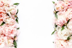 Flower border frame made of pink and beige buds peony bouquet on a white background. The apartment lay, top view. Floral texture background.