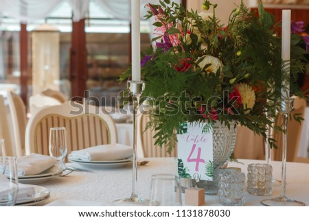 flower composition and candles in the restaurant. Wedding dinner #1131878030