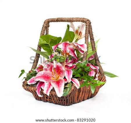 Flower composition with lilies in basket