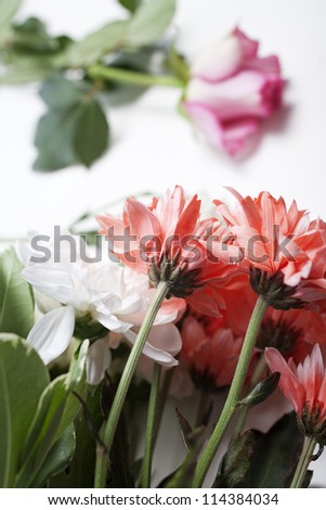 Flower cuttings being prepared to be arranged to make a bouquet.