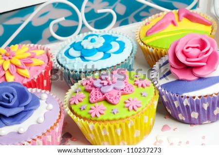 Flower decorated cupcakes for birthday or wedding celebration