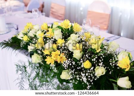 Flower decoration on wedding table - stock photo