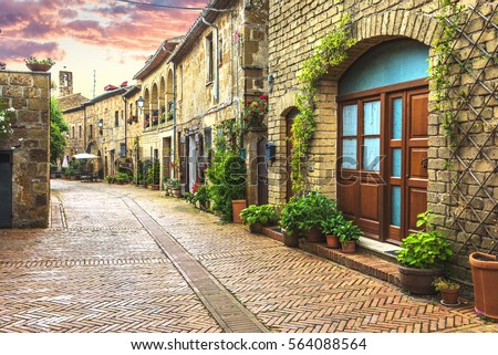 Flower filled streets of the old Italian city in Tuscany. #564088564