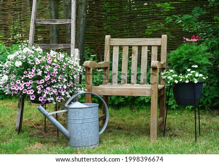 Flower garden Growing own flowers and plants. Urban botanical english garden. the garden of Eden. a nice summer garden in the woods. english cottage style gardening. nice landscaped. Stock photo ©