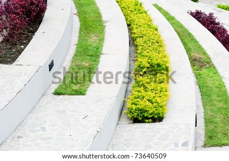 Flower garden tract of white stairs inside the hotel