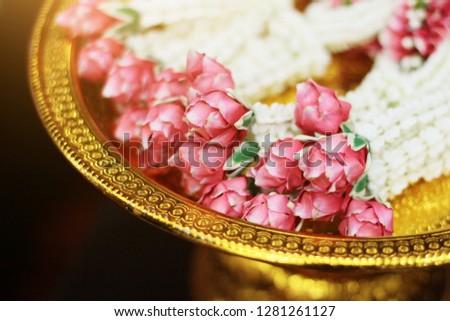 Flower garlands on a gold tray in tradition Thai wedding ceremony day. Jasmine garland. #1281261127