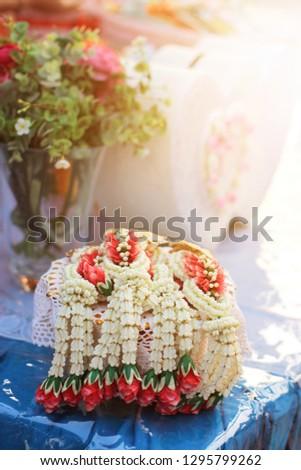 Flower garlands on a gold tray in tradition Thai wedding ceremony day. Jasmine garland. #1295799262