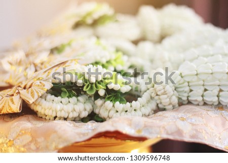 Flower garlands on a gold tray in tradition Thai wedding ceremony day. Jasmine garland. #1309596748