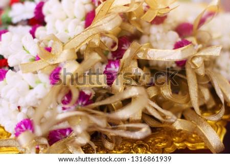 Flower garlands on a gold tray in tradition Thai wedding ceremony day. Jasmine garland #1316861939
