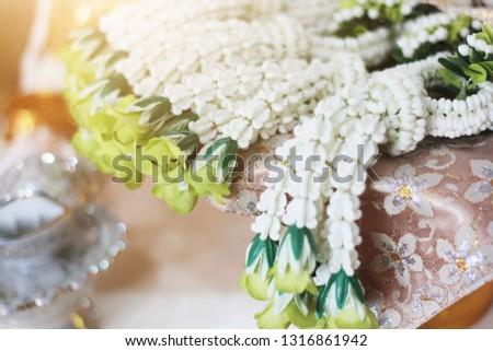 Flower garlands on a gold tray in tradition Thai wedding ceremony day. Jasmine garland #1316861942