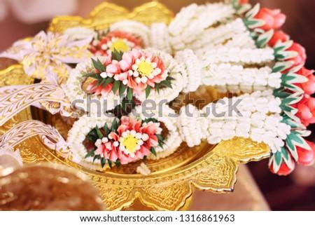 Flower garlands on a gold tray in tradition Thai wedding ceremony day. Jasmine garland #1316861963