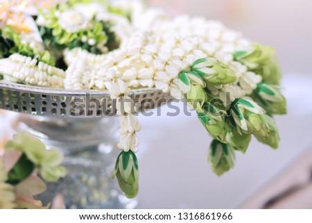 Flower garlands on a gold tray in tradition Thai wedding ceremony day. Jasmine garland #1316861966