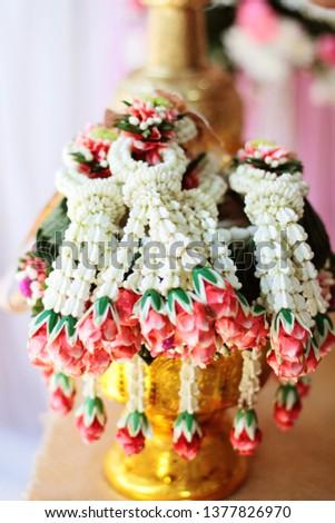 Flower garlands on a gold tray in tradition Thai wedding ceremony day. Jasmine garland. #1377826970