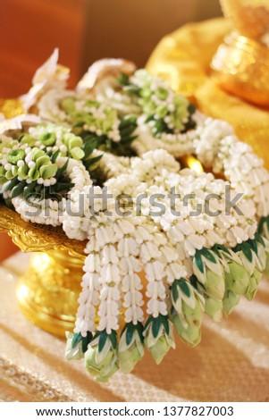 Flower garlands on a gold tray in tradition Thai wedding ceremony day. Jasmine garland. #1377827003