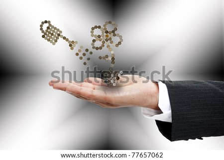 flower growing from pile of coins - stock photo
