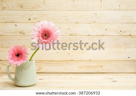 flower in cup with pine wood...