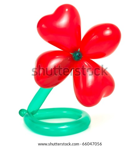 Flower made from vibrant twisted balloons isolated on white background.